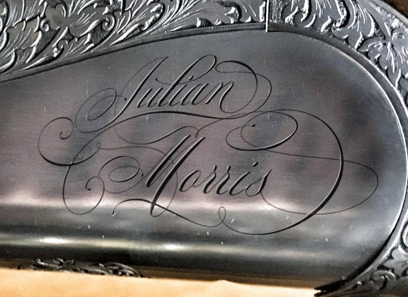Julian Morris - Hand finished calligraphic logotype gun metal render